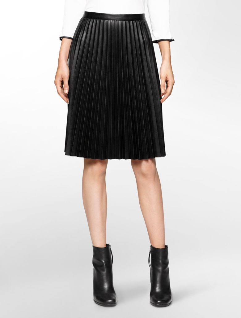 More Details Elie Saab Short Pleated Leather Skirt with Stud Details Details Elie Saab pleated leather skirt with stud details. Mid-rise; flat front. Mid-rise; flat front. Hidden back zip.