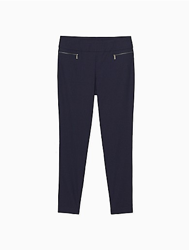 Designed with an allover trinity pattern, these polished pants are crafted from a soft stretch blend with pull-on styling. Finished with a banded waist, front zip pockets, straight legs and seaming details.