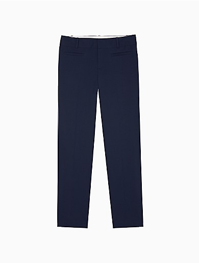 part of our modern essentials collection, these solid pants are made with an extra soft cotton stretch blend for all-day comfort. designed with a tab closure for a clean look, front and back welt pockets, a logo plaque and ankle length styling. versatile and modern, this streamlined choice is a collection building-block essential.