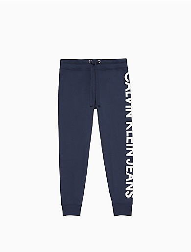 Styled with an oversized logo at the side, these effortless performance joggers are crafted from a plush cotton knit blend. Finished with a drawstring waistband, straight legs and banded ankles with ribbed knit trim.