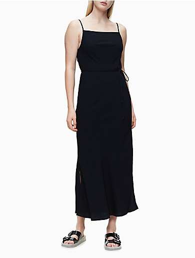 A minimalist form with solid fabric and a straight drape, this sleeveless maxi-length dress is crafted from smooth twill. Features a square neckline with slim adjustable shoulder straps, a self-tie at the waist, side vents and unlined construction for a flowing look and feel.