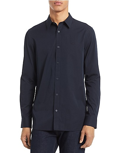 the cotton cashmere shirt. made with a solid look and a super soft cotton modal cashmere blend, this long sleeve shirt features a point collar, button closures, a ck logo and classic fit styling. a curated capsule of timeless styles, perfected for the modern wardrobe. refined and relevant pieces to take you from the weekday to the weekend.