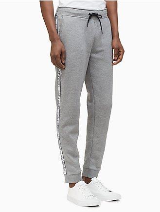 04670c3258e regular fit knit logo tape jogger sweatpants