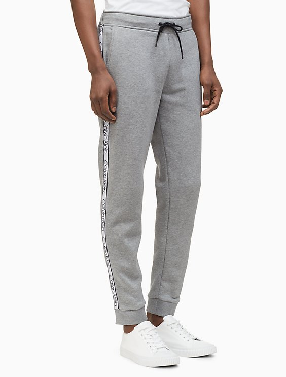 25d5386e1c7ded regular fit knit logo tape jogger sweatpants | Calvin Klein