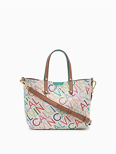 Designed with an allover monogram logo and a textured feel, this small crossbody bag features an adjustable crossbody strap, dual carry handles, a top snap closure, a logo print and multiple pockets.