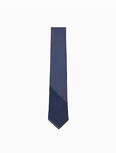 a slim width tie crafted with silk, a stripe logo design and a full lining.