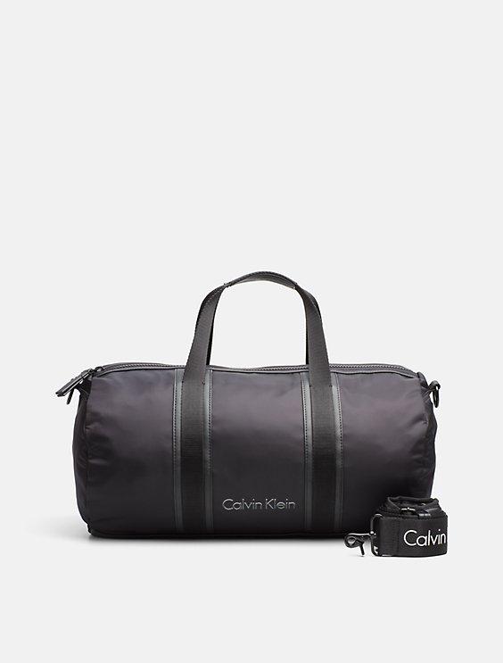 47a9560448f nylon cylinder weekender duffle bag | Calvin Klein