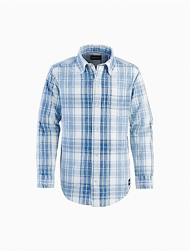 With the look of a classic favorite, this boys CALVIN KLEIN JEANS shirt features intricate faded fabric in a washout plaid pattern. Designed with a point collar, barrel button cuffs, button-down closures at front, a woven logo tag at the side and a shirttail hem for an effortless style at home at the beach or a special summer event.
