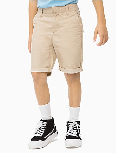 go from playground to party in these versatile chino shorts. crafted from a durable rip stop cotton, these shorts combine comfort and durability with smart everyday style.