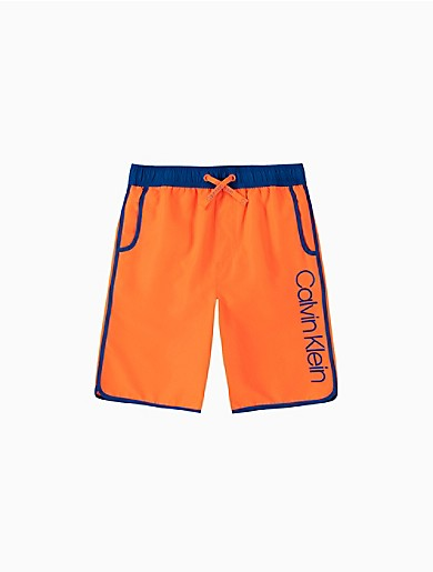 Crafted from lightweight fabric with quick-dry technology, these boys volley swim shorts are designed with a drawstring waistband, front slip pockets, contrast trim and an updated Calvin logo at the front.
