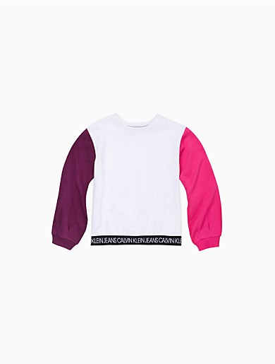 Styled with a solid body and bold, vibrant colorblock sleeves, this girls pullover sweatshirt is made from a cotton knit blend with a crewneck, a repeating logo waistband and ribbed knit trim.